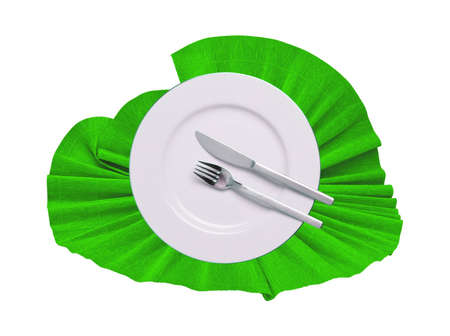 Fork, knife and white plate on green cloth isolated on white photo