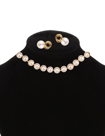beautiful necklace and earrings with pearls isolated on white photo