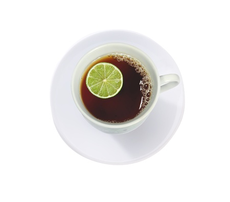 cup of tea with lime (lemon) isolated on white photo