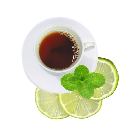 cup of tea with mint and fresh lime (lemon) slices isolated on white background photo