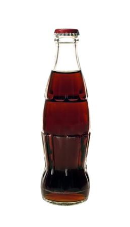 soda bottle: glass bottle of cola soda isolated on a white background Stock Photo