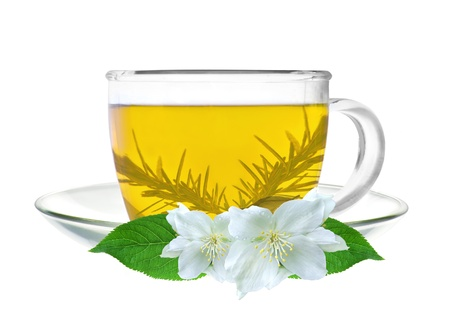 glass cup of green tea with jasmine flowers isolated on white photo