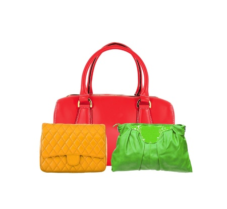 Colorful women bags isolated on white background photo