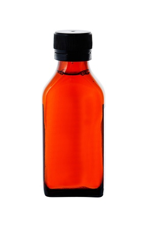Close up on a medicine bottle with red syrup isolated on white background  photo