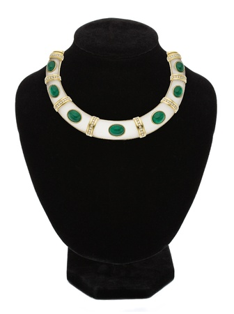 beautiful jewellery necklace with green stone on black mannequin isolated on white  photo