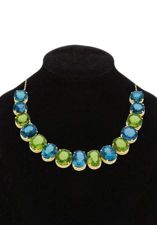 Pendant with green and blue gem stones on black mannequin isolated on white Stock Photo - 14068071