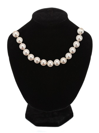 Pearl necklace on black mannequin isolated on white photo