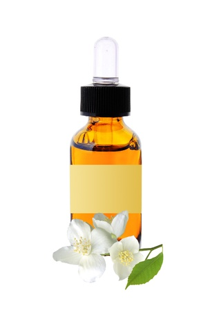 jasmine flower: bottle with essence oil and jasmine flower isolated on white Stock Photo