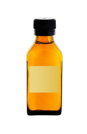 medicine bottle with yellow syrup isolated on white background photo
