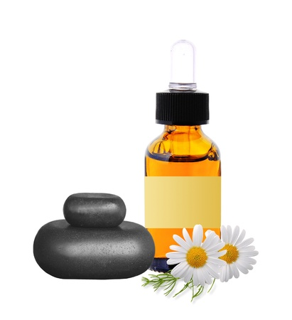 black spa stones, bottle with essence oil and chamomile flowers isolated on white background Stock Photo