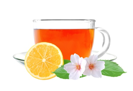 Glass cup tea with lemon and jasmine flowers isolated on a white background photo