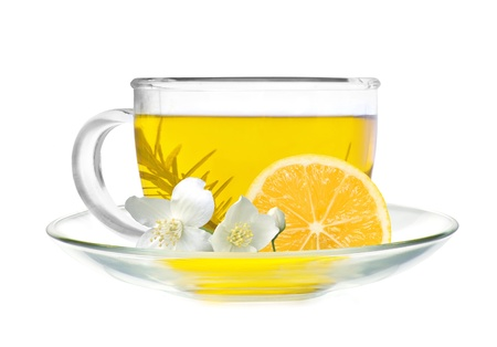 cup of green tea with lemon slice and jasmine flowers isolated on white background photo