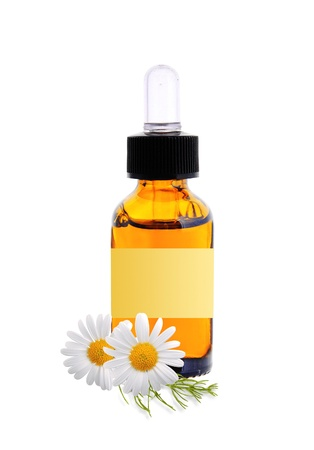 bottle with essence oil and chamomile flowers isolated on white background photo
