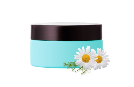face cream and chamomile flowers isolated on white background photo