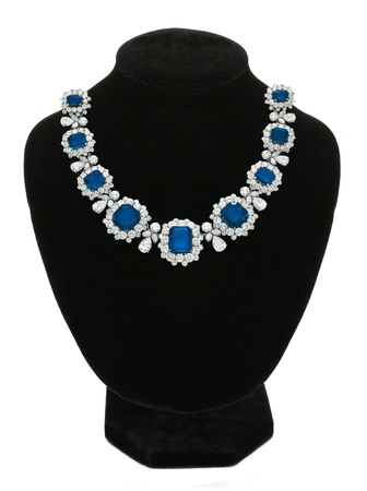 diamond necklace: Pendant with blue gem stones on black mannequin isolated on white