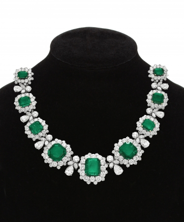 Pendant with green gem stones on black mannequin isolated on white 스톡 콘텐츠