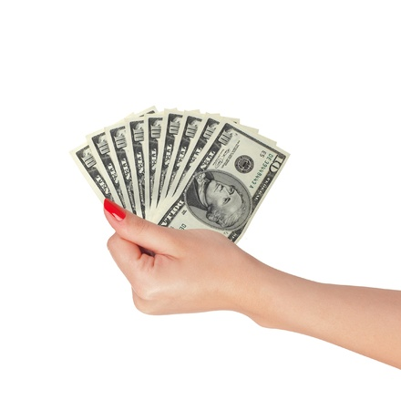 American dollars in a women hand isolated on white background photo