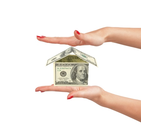dollar house on woman hand isolated on white background