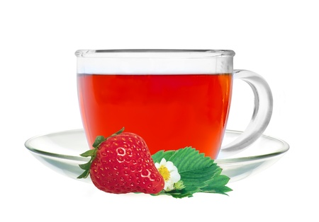 Glass cup tea with strawberry and green leaves isolated on white background photo