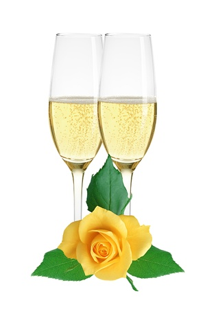 Two glasses of champagne and yellow rose isolated on white background photo