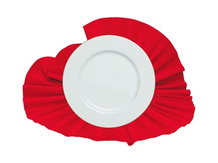 white plate on a red cloth isolated on white photo