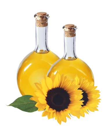 oil in bottles and sunflowers, isolated on white background photo