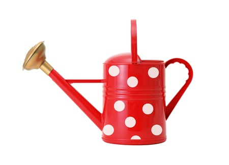 red polka dot watering can isolated on white photo