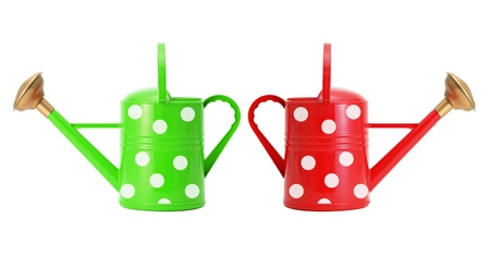 red and green polka dot watering cans isolated on white Stock Photo - 14901157