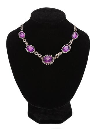 Diamond necklace on black mannequin isolated on white background  photo