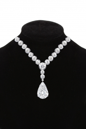 diamond necklace: Diamond necklace on black mannequin isolated on white background