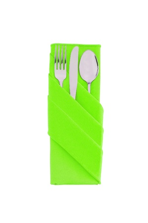 Fork, spoon and knife in green cloth isolated on white background photo