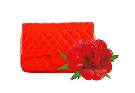 Red women bag and peony flower isolated on white background photo