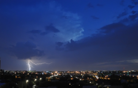 Lightning strike over night city photo