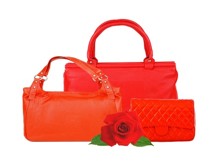 Red women bags and rose flower isolated on white background photo