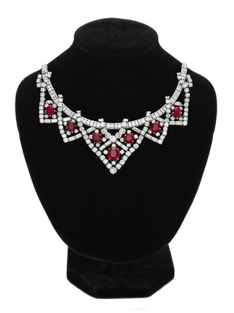 Pendant with red gem stones on black mannequin isolated on white Stock Photo - 15898713