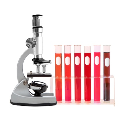 Medical test tubes with blood in holder and microscope on white background Stock Photo - 15898832