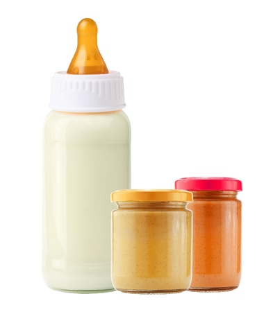 baby food and and milk bottle isolated on white background photo