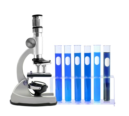 Medical test tubes in holder and microscope on white background Stock Photo - 17859722