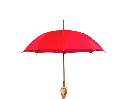 Red umbrella in hand isolated on white background photo