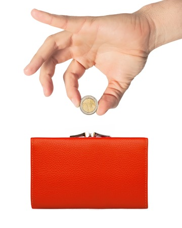 red purse (wallet) and hand with coin isolated on white background photo