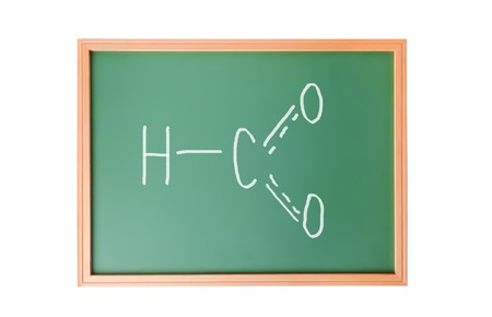 Chemical structure formula written on blackboard with chalk photo