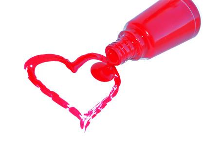 close up of nail polish heart shapes on white background