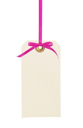 cardboard tag with pink ribbon and bow isolated on white background photo