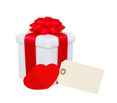 Gift box with red ribbon, hearts and tag (label) isolated on white  photo