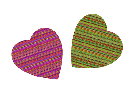 Colorful textile hearts isolated on white  photo