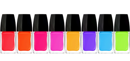 set of colorful nail polishes isolated on white  photo