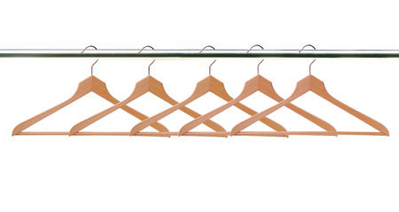 wooden clothes hangers isolated on white background photo
