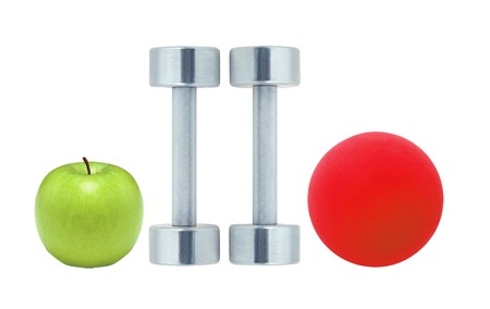 Chromed fitness dumbbells, red ball and green apple isolated on white background photo