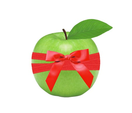 Fresh green apple and red bow isolated on white background photo