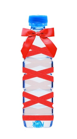 plastik: Blue bottle of water with red bow isolated on white background